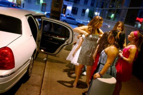 Girls going to prom in a limousine
