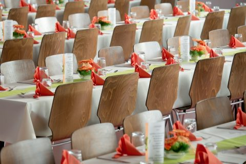 wooden seats with tables and napkins