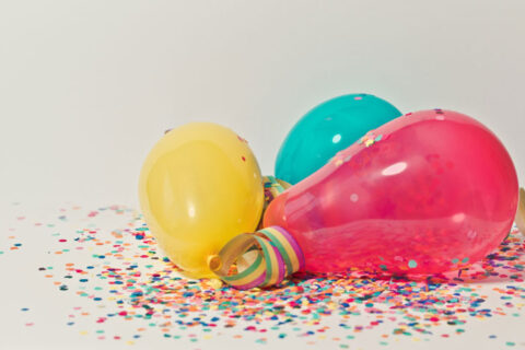 three colorful balloons on the floor